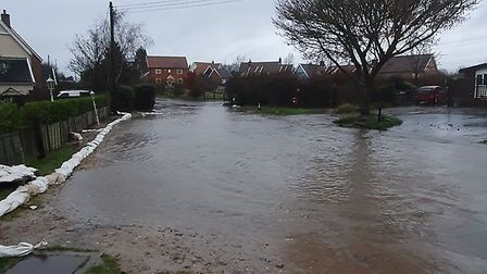 The junction of Aldeburgh Road and the B1353 (Aldringham Lane) is flooded, directly outside The Parr