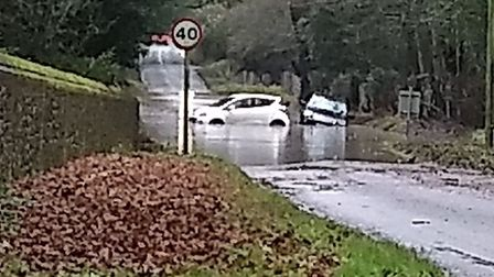 A car at a crossroads in Nowton hit trouble after the road flooded on December 20 Picture: MALCOLM G
