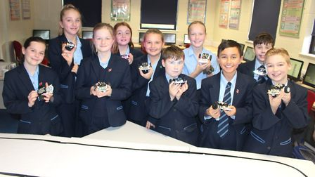 Pupils at Newmarket Academy are learning to use robotics to help them teach younger students about s