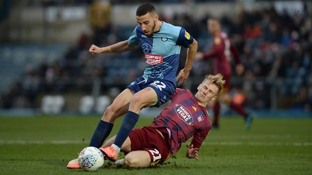 Flynn Downes slides into a challenge on Nick Freeman at Wycombe Wanderers Picture Pagepix