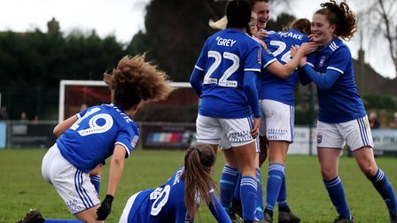Ipswich Town players celebrate Paige Peake's winning goal as the Tractor Girls progressed to the fou
