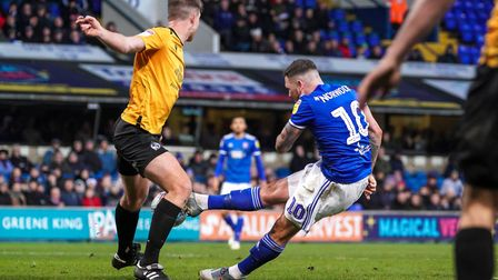 James Norwood shoots late in the first half but his shot canons off the legs of Tony Craig.Pict
