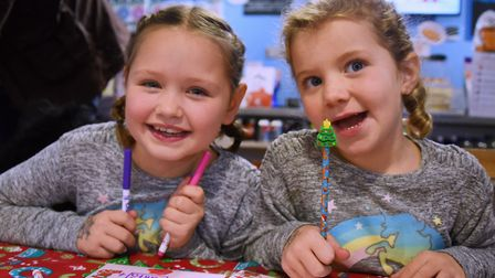 Cousins Elsie Marjoram, eight, left, and Ivy Woodward, five, finish their letters to Santa ready to