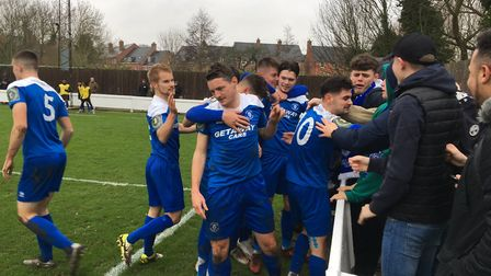 All smiles as Bury Town players celebrate with home fans at Ram Meadow after taking a 1-0 lead again