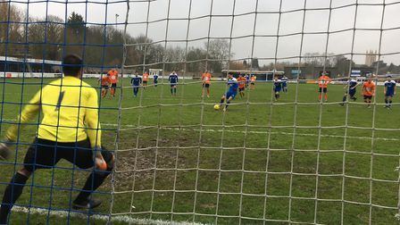Cemal Ramadan steps up to convert this penalty past Soham keeper Josh Pope. Picture: CARL MARSTON