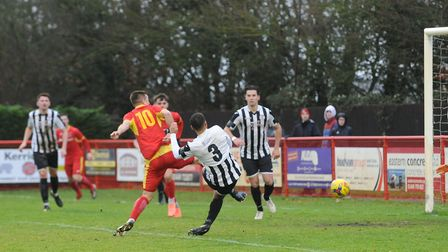 Craig Parker gets in front of his defender to put Needham Market ahead against St Ives. Picture: BEN