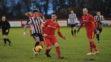 Needham's new signing Billy Hunt in action against St Ives. Picture: BEN POOLEY