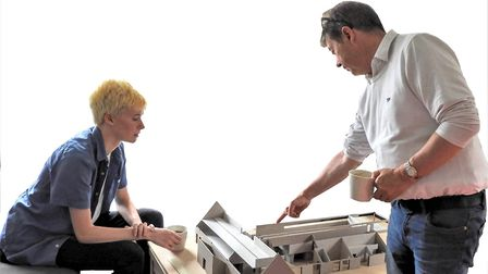 Architect Scott Mortimer and modelmaker Jack Bennett with the 3D model of the community, youth and a