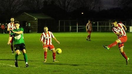 Felixstowe & Walton United's Stuart Ainsley lets fly from outside the area. Picture: MICK WARD