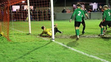 Joseph Yaxley (partly obscured) scores for the Seasiders against Soham Town Rangers. Picture: MICK W