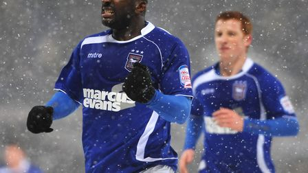Jason Scotland scored two of Ipswich Town's goals in their snow-covered 3-0 win over Leicester City