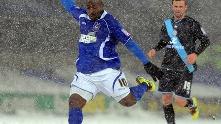 Jason Scotland scores one of his goals in the snow