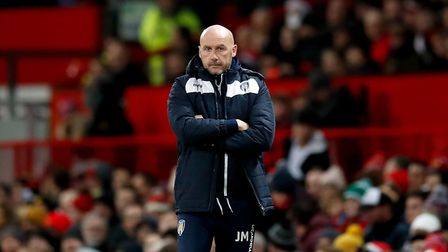 Colchester United's manager John McGreal during the Carabao Cup quarter final match at Old Trafford.