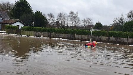 The B1353 had flooded, but staff at the Aldringham pub found alternative transport to get through th