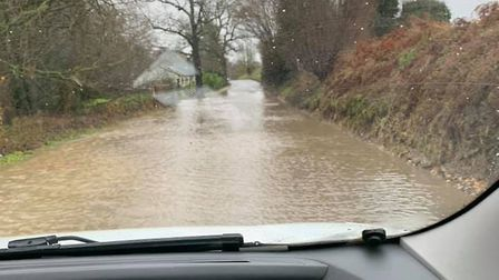 The road between Monks Eleigh and Sudbury was covered in debris and flood water on December 21 Pictu