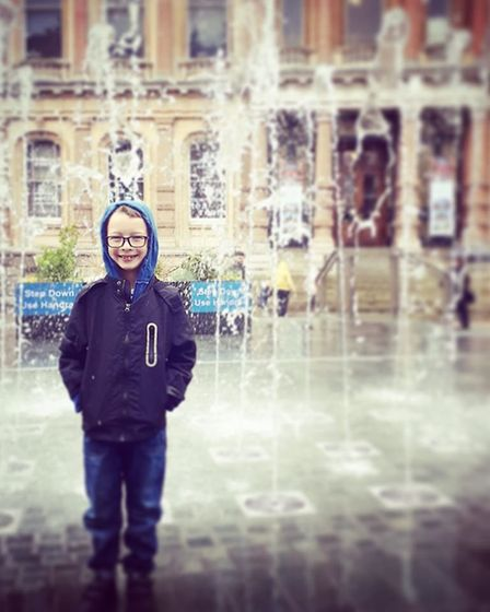 Lucas, seven, pictured outside Ipswich Town Hall Picture: POPPY ADAMS