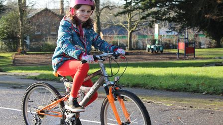 Ella Sandford tries out the new cycling proficiency area in Belle Vue Park, Sudbury Picture: BDC