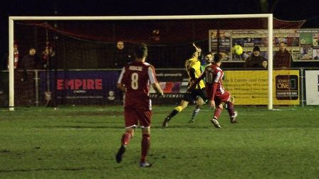 Ollie Canfer calmly lobbing the keeper for Felixstowe and Walton United's second. Photos: DAVE FRANC