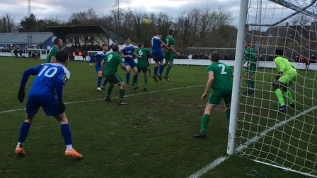 Canvey Island keeper Emmanuel Idem protects his goal as Bury Town force the pace, at Ram Meadow this