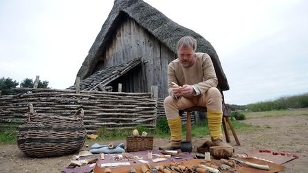 West Stow Anglo Saxon village - re-enactor Neil Paull making a comb from bone. Picture: PHIL MORLEY
