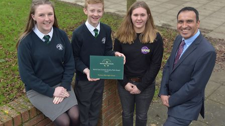 . Jade Bishop, Tom Alexander, Bea Trott and headteacher Phil Hurst with the school's award Picture: