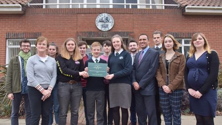 Staff and students at Thomas Mills pose with their award Picture: SONYA DUNCAN