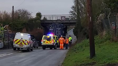 A lorry is lodged under Saxham railway bridge and trains between Cambridge and Bury St Edmunds are s