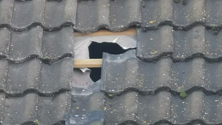 The hole Parfett punched in the roof at the house in Boughton Way Picture: SIMON BENDALL