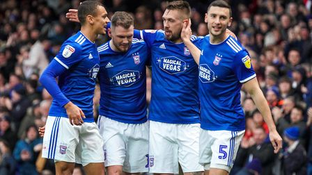 Kayden Jackson, James Norwood, Luke Chambers and James Wilson celebrate after Town's third goal.