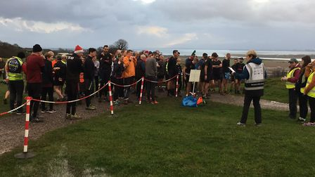 Runners and walkers congregate in the cold and wet before the start of the Hadleigh parkrun last mon