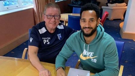 Jordan Roberts, pictured with Gillingham chairman Paul Scally. Picture: GILLINGHAMFC