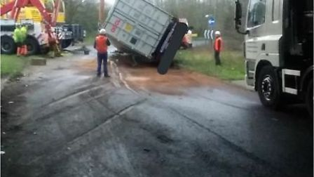 A lorry has been recovered after overturning on a roundabout connecting the A140 and the A14. Pictur