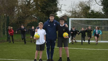 Ipswich Town's Zak Brown with Daniel and Charlie at the opening of Colneis' new multi-use game area