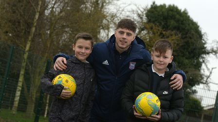 Oliver and Keaton pose with the professional footballer Picture: SARAH LUCY BROWN