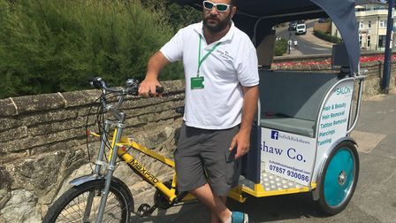 Riding a rickshaw in Felixstowe is an unusual way to celebrate Suffolk. Pictured here is Ian Lightfo