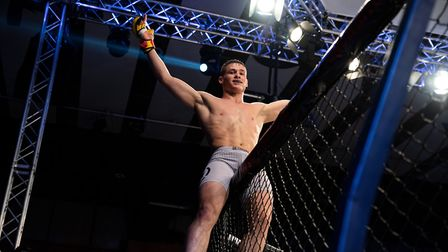 George Tanasa celebrates after defending his featherweight belt at Cage Warriors 105. Picture: BRETT