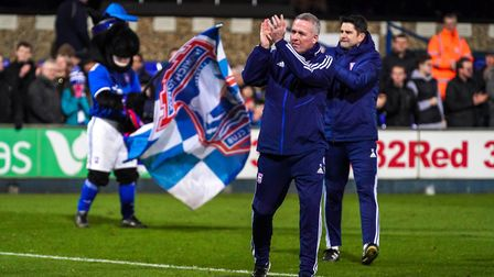 Town manager Paul Lambert and his assistant Stuart Taylor applaud fans after the game.Picture