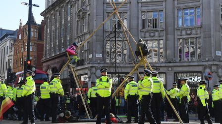 Protesters block the road at Oxford Circus, London, during an Extinction Rebellion (XR) climate chan