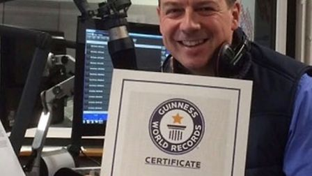 Luke Deal with his Guinness World Record certificate for naming the most ABBA songs from their lyric