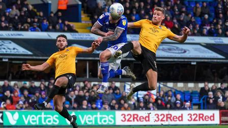 James Norwood makes contact with the ball as he heads a goal back for TownPicture: Steve Waller