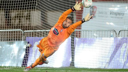Bartosz Bialkowski cannot stop the second penalty from finding the net at Exeter Picture Pagepix