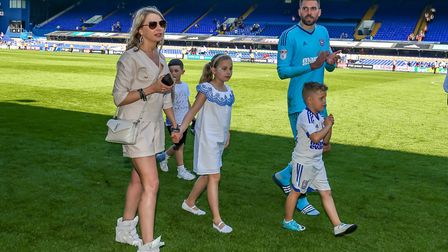 Bartosz Bialkowski and family walk the pitch following the Town v Middlesbrough match in 2018. P