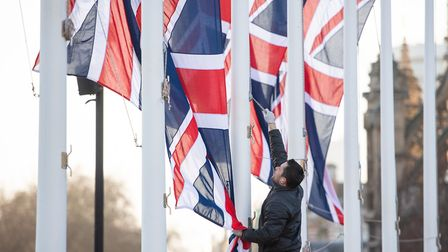 Union flags come down after last Friday's Brexit celebration in Parliament Square - now the hard wor