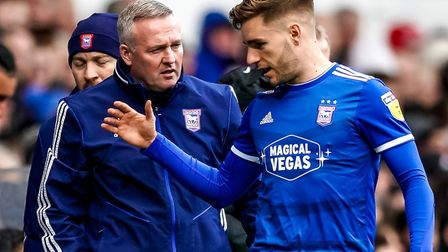 Town manager Paul Lambert has a word with Luke Garbutt as he heads back to the dressing room after h