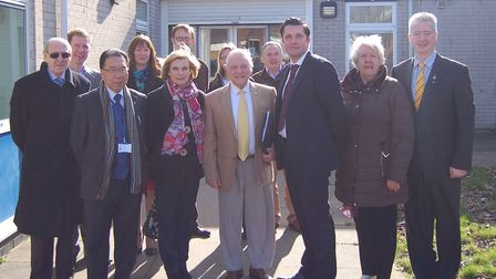 This image includes councillor Paul Hopfensperger (far right) in front of the current Newbury Commun