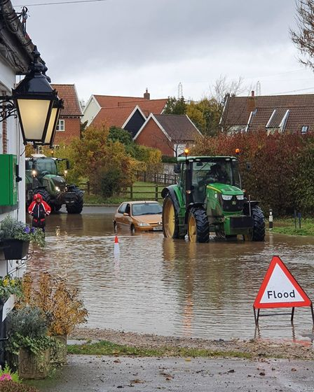 A car stuck in the water after heavy flooding Picture: CHRIS THEOBALD