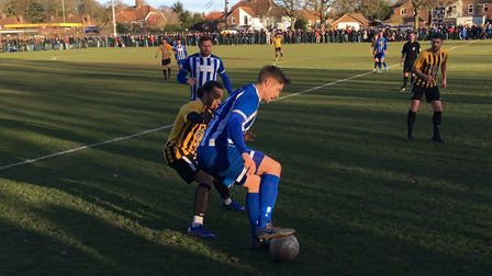 Wroxham winger Shaun Taylor is closely marked by Ollie Brown during this afternoon's FA VAse fifth r