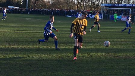 Stowmarket Town striker Josh Mayhew on the ball at Wroxham this afternoon. Picture: CARL MARSTON