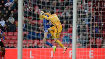 Emyr Huws gets a forearm to the head from keeper Jon McLaughlin at Sunderland Picture Pagepix