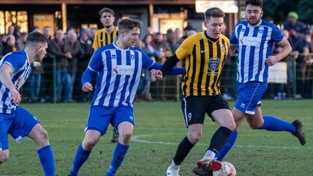 Stowmarket Town striker Christy Finch is surrounded by Wroxham opponents during Saturday's 2-0 defea